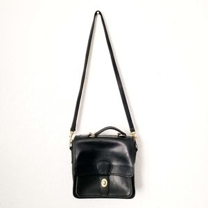 Coach: Vintage Black Leather Crossbody Saddle Bag